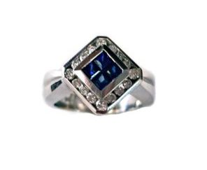 final3 1 e1509755473568 296x243 - Invisible-Set Sapphire and Diamond Ring